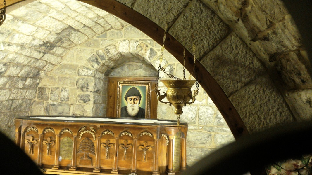 """LLEW [<a href=""""https://creativecommons.org/licenses/by-sa/4.0"""" target=""""_blank"""">CC BY-SA 4.0</a>], <a href=""""https://commons.wikimedia.org/wiki/File:Charbel_Makhlouf_grave.JPG"""" target=""""_blank"""">via Wikimedia Commons</a>"""