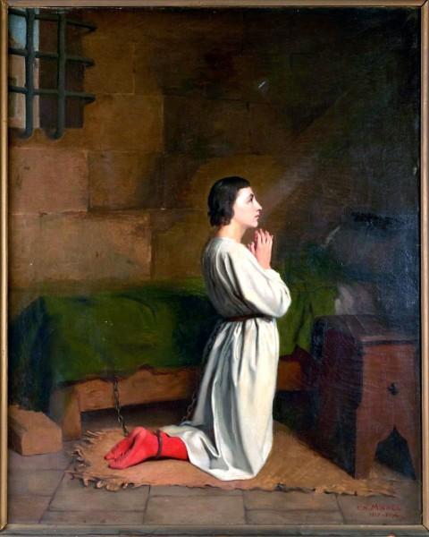 "Joan of Arc imprisoned, in prayer, oil on canvas, apocryphal signature lower right ""C.H.MICHEL 1817-1904   <a href=""https://commons.wikimedia.org/wiki/File:Jeanne_d%27arc_emprisonn%C3%A9e,_en_pri%C3%A8re.jpg"" title=""via Wikimedia Commons"" target=""_blank"">Charles-Henri Michel (1817-1905) (attribué à)</a> / Public domain"